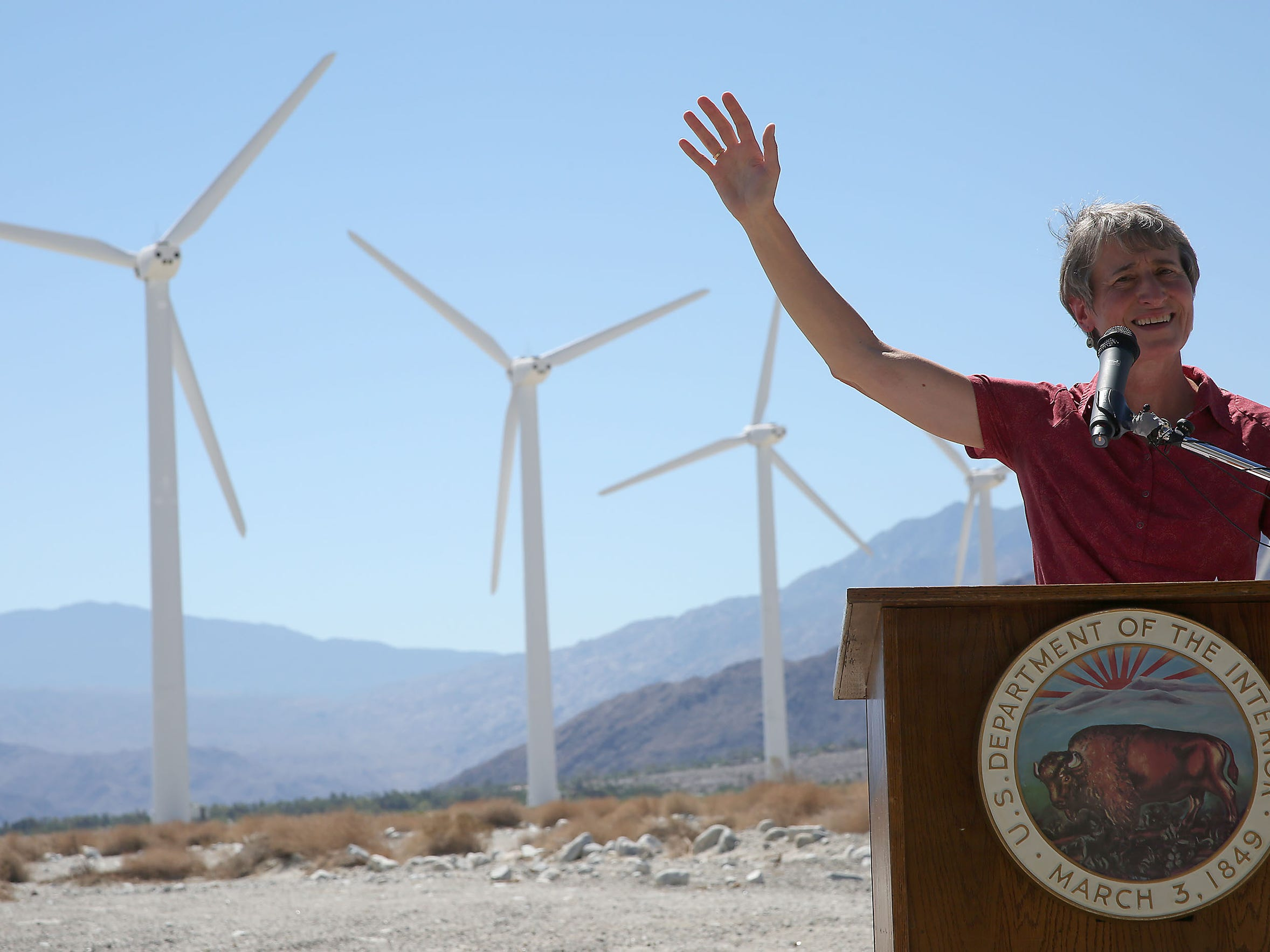 Then-Interior Secretary Sally Jewell announces a draft version of the Desert Renewable Energy Conservation Plan at a wind farm north of Palm Springs on Sept. 23, 2014.