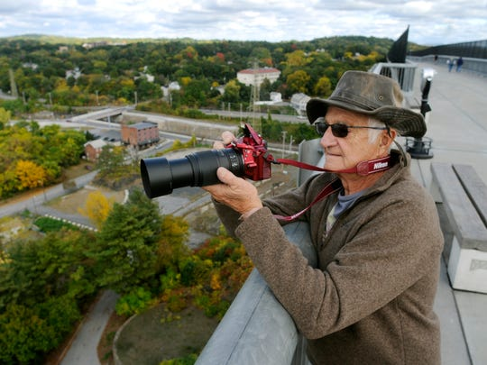 Paul Miller of Highland Mills takes photographs from the Walkway Over the Hudson on Thursday from the eastern side of the Hudson River span. Oct. 2, 2014