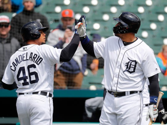 Tigers third baseman Jeimer Candelario (46) celebrates his solo home run with first baseman Miguel Cabrera in the third inning on Wednesday, April 18, 2018, at Comerica Park.