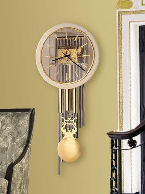 The Focal Point Wall Clock 65 by Howard Miller.