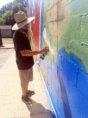 Artist Perry Hodson puts the finishing touches on his