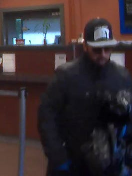 Bank photo shows alleged robber leaving Chase Bank branch in Freedom Plains.