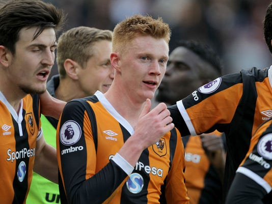Hull City's Sam Clucas, center, celebrates scoring his side's second goal of the game during their English Premier League soccer match against Watford at the KCOM Stadium, Hull, England, Saturday, April 22, 2017. (Richard Sellers/PA via AP)