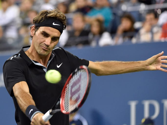 Roger Federer hits to Sam Groth on day five of the 2014 U.S. Open tennis tournament at USTA Billie Jean King National Tennis Center.