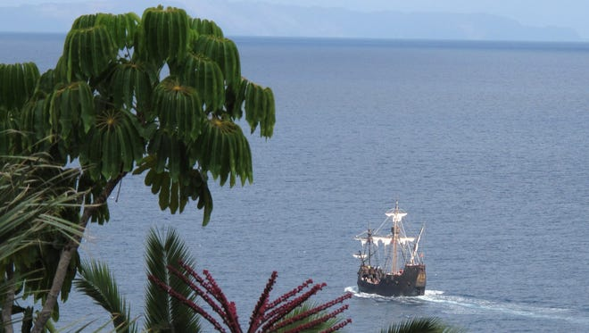 A replica of Christopher Columbus' flagship, the Santa Maria, makes its way past the Portuguese island of Madeira on Sept. 12, 2011.