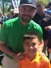 Charlie Danuloff with pop star Justin Timberlake, a surprise visitor during Charlie's practice round.