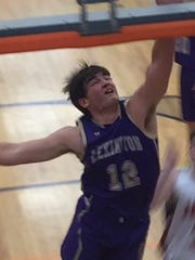 Lexington's Ben Vore crashes the boards in Tuesday's Ohio Cardinal Conference game at Mount Vernon.