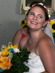 Bride Nicole Wismer smiles before her wedding ceremony
