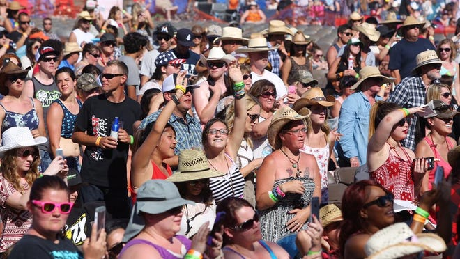 Thousands that gathered cheer on Chase Bryant at the International Agri-Center for JugFest on Saturday, May 30, 2015 in Tulare, Calif.