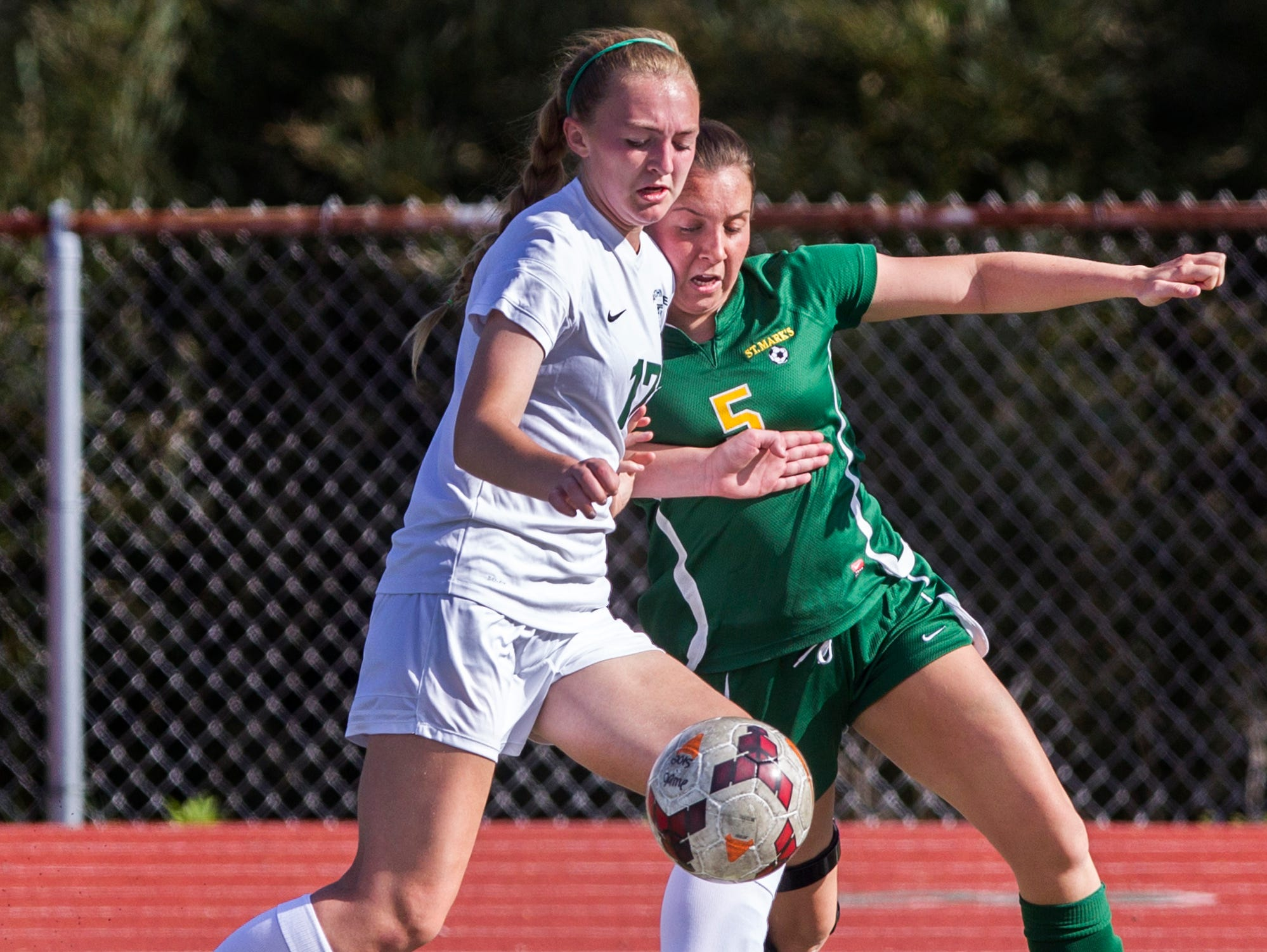 Archmere's Lauren Murray (No. 17) and St. Mark's Claire Igo (No. 5) fight for position on the ball during a game at Archmere on Wednesday afternoon. Archmere defeated St. Mark's by a score of 2-1.
