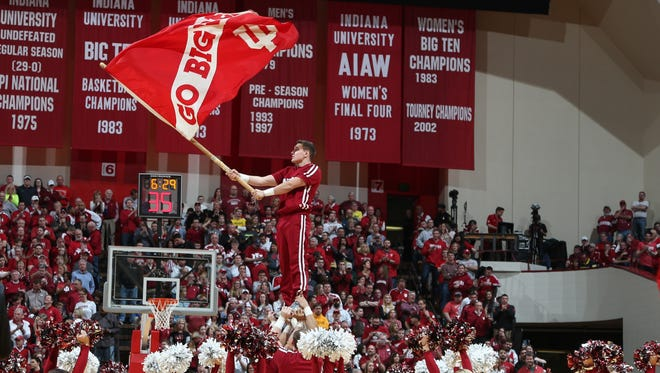 Feb 8, 2015; Bloomington, IN, USA; Indiana Hoosiers cheerleaders cheer from the court during a time-out against the Michigan Wolverines at Assembly Hall. The Hoosiers won, 70-67.