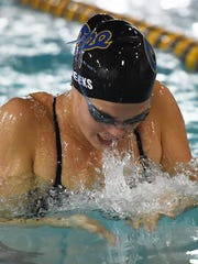 Cape's Molly Weeks does the breaststroke in the girls