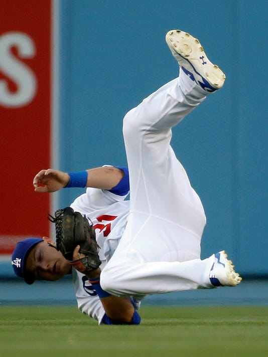 Los Angeles Dodgers center fielder Joc Pederson catches a fly ball hit by San Francisco Giants' Matt Duffy during the second inning of a baseball game in Los Angeles, Saturday, April 16, 2016. (AP Photo/Chris Carlson)