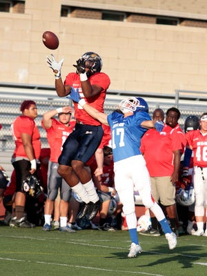 Charles Gaines of Lloyd goes up and gets the ball for a West first down at Dixie Heights High School.
