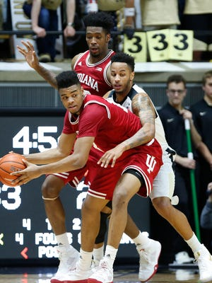 Vincent Edwards drapes himself over Juwan Morgan of Indiana Tuesday, February 28, 2017, at Mackey Arena. Purdue defeated rival Indiana 86-75 to claim at least a share of the Big Ten regular season title.
