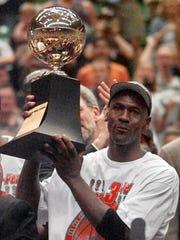 Series MVP Michael Jordan holds the MVP trophy after