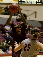 Midwestern State's Micheline Mercelita shoots over