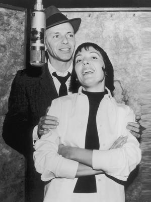 Keely Smith (right) was linked personally, professionally and artistically to Frank Sinatra, shown in a recording studio with Smith.