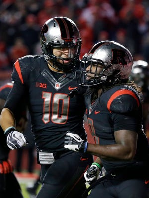 Rutgers quarterback Gary Nova (10) celebrates with running back Josh Hicks (8) after Hicks scored a touchdown in last week's 45-23 win over Indiana.
