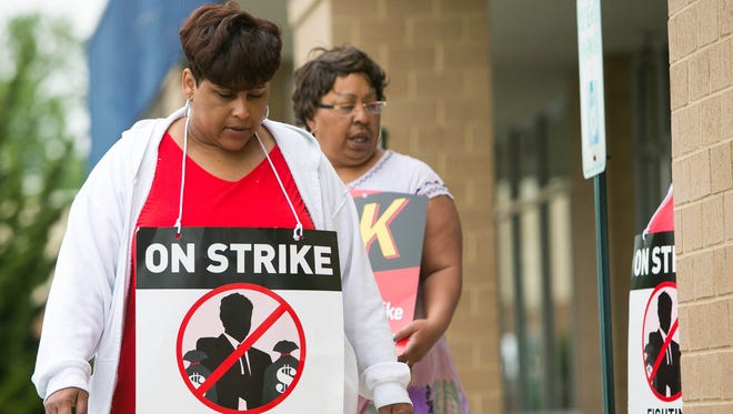 Nicole Preston (left) who's been a Verizon employee for 23 years pickets at the Verizon store on Kirkwood Highway in Wilmington. On Thursday, Verizon and and the union will state their case before a Delaware judge.