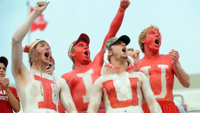 FILE – Indiana University football fans Kyle Gallahan,left, Nick James, Jeff Dubish and Jacob Jackson, right, cheer on their Hoosiers.
