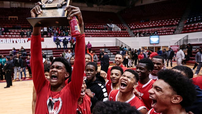 Edison players celebrate winning the Detroit Public School League championship game after defeated Pershing 82-45 at University of Detroit Mercy in Detroit, Friday, February 16, 2018.