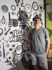 Jaime Walton collects tools at his JME Makes workshop in Railroad Square.