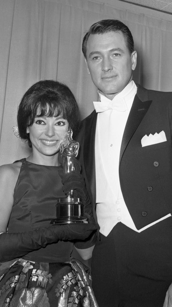 Rita Moreno with her Oscar and actor Rock Hudson in