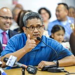 An overflow of attendees can be seen seated outside the public hearing room during the confirmation hearing of Guam Police Department acting Chief of Police Joseph Cruz at the Guam Legislature in Hagatna on Monday, July 27.