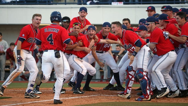 Tate Blackman (4) runs home and toward his teammates after he hit a walk-off home run against Alabama Saturday.