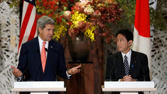 Secretary of State John Kerry speaks at at a joint news conference with Japan's Foreign Minister Fumio Kishid in Tokyo on Thursday.