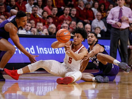 Iowa State freshman Lindell Wigginton gets a pass away after securing a loose ball against TCU on Wednesday, Feb. 21, 2018, at Hilton Coliseum in Ames.