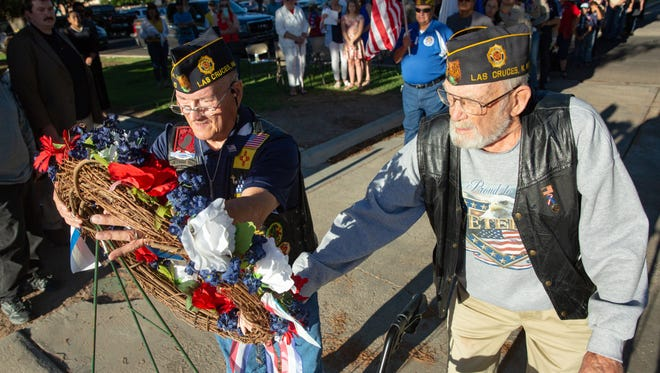 U.S. Military Veterans Lawrence Orvis, left, and Walter Baker, both of Las Cruces, lay a memorial wreath on Sunday, May 27, 2018, during tenth annual The American Legion Post 10 wreath memorial at St. Joseph's Cemetery.