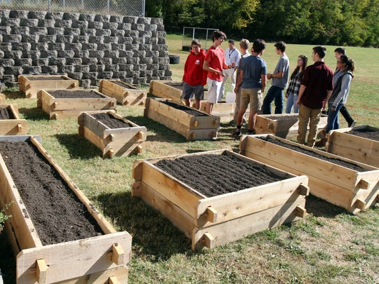 Middletown High School South environmental club stand in the new student-run garden, which received a $2,000 grant for the garden and will produce food for a local food bank.
