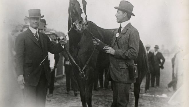 Trainer James Rowe, left, Regret and owner H.P. Whitney enjoyed the Kentucky Derby win in 1915.
