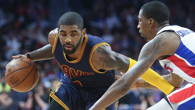 Pistons guard Kentavious Caldwell-Pope defends against Cavaliers guard Kyrie Irving during the third period Friday at the Palace.