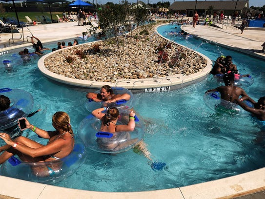 Swimmers float around the lazy river at Adventure Cove