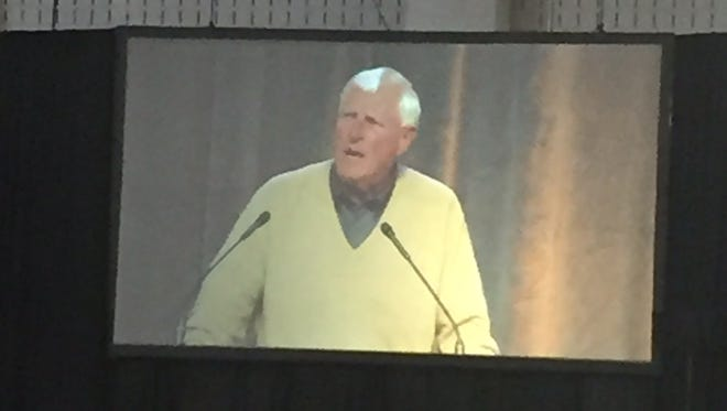 The image of former Indiana University basketball coach Bob Knight's speech is projected on large screens during today's Purdue Ag Alumni Fish Fry at the Indiana State Fairgrounds. Though he was wearing a beige sweater, the lighting made it almost resemble Purdue gold.