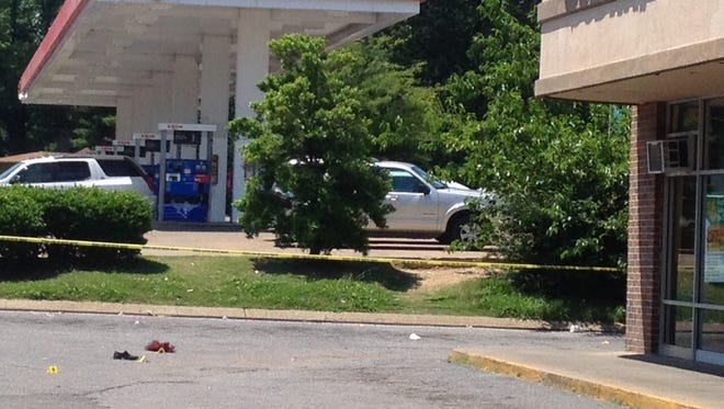 A red wig and a shoe were among the evidence lying in a restaurant parking lot following a shooting near the intersection of Summer Avenue and East Parkway.