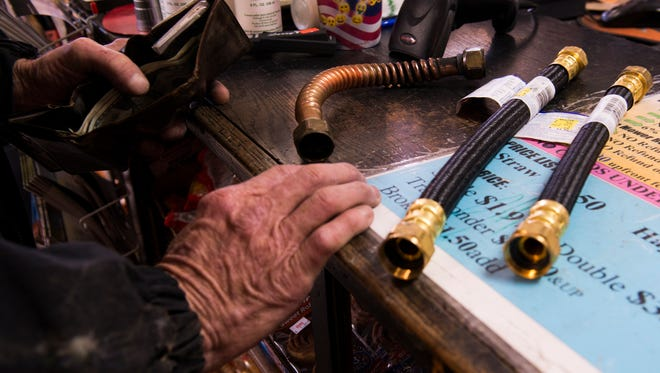 A customer buys some materials from Hardware City to address a frozen pipes issue at home.