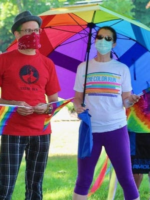 Lauren Allansmith, standing with Itai Halevi, brought her big rainbow umbrella to the first Scituate Pride Parade.