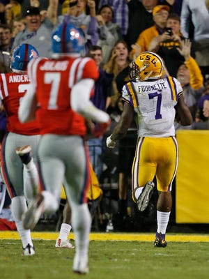 LSU running back Leonard Fournette (7) looks back as he runs into the end zone for a touchdown during the first half an NCAA college football game against Mississippi in Baton Rouge, La. Saturday.