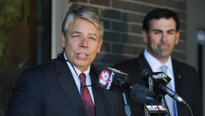 Mitch Tyner, attorney for the Chris McDaniel campaign, is joined by State Sen. Michael Watson, R-Pascagoula, outside the Tyner Law Firm in Jackson on Wednesday during a press conference regarding the campaign's ongoing investigation into election irregularities and voter fraud.