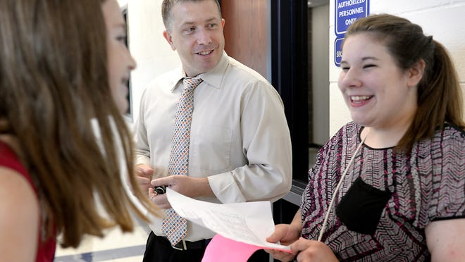 East Lansing High School Principal Coby Fletcher talks with students at the school In 2014.