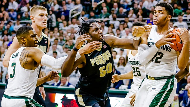 Miles Bridges ,right, of MSU rips a rebound away from Caleb Swanigan ,50, of Purdue.
