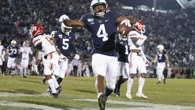 Penn State running back Journey Brown (4) celebrates his touchdown run against Rutgers during a Big Ten Conference game Nov. 30 in State College, Pa.