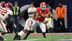 Georgia quarterback Justin Fields runs the ball against