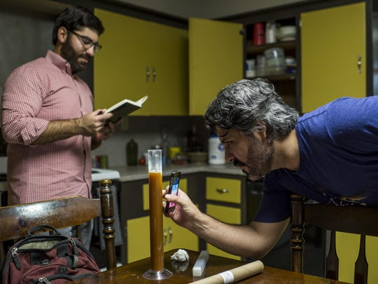 Daniel Amire and Hunter Hebert analyze a sample of a batch of beer at Hebert's home in Lafayette, LA, Thursday, Aug. 20, 2015. Amire and Hebert have begun homebrewing under the moniker Hub City Beerworks at Hebert's home.