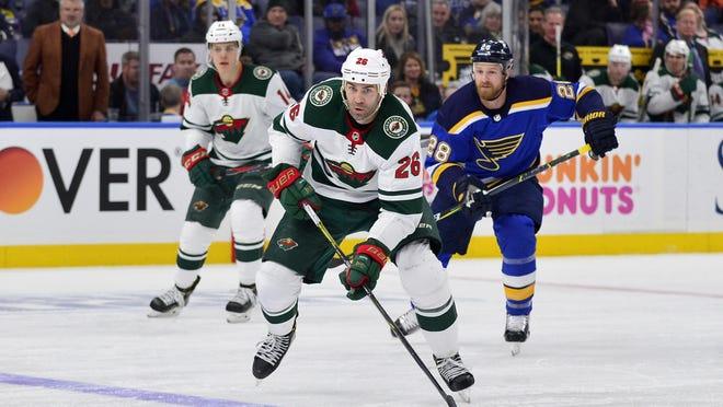 Feb 6, 2018; St. Louis, MO, USA; Minnesota Wild left wing Daniel Winnik (26) handles the puck during the third period against the St. Louis Blues at Scottrade Center. Mandatory Credit: Jeff Curry-USA TODAY Sports