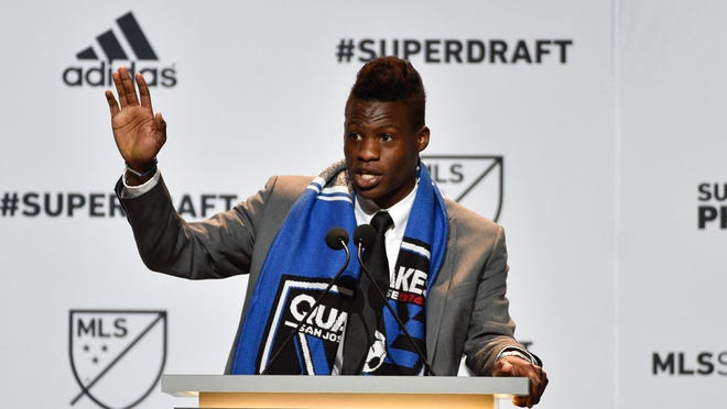 Former MSU midfielder Fatai Alashe talks to the crowd after being drafted as the No. 4 overall pick by the San Jose Earthquakes in the 2015 MLS SuperDraft on Thursday in Philadelphia.